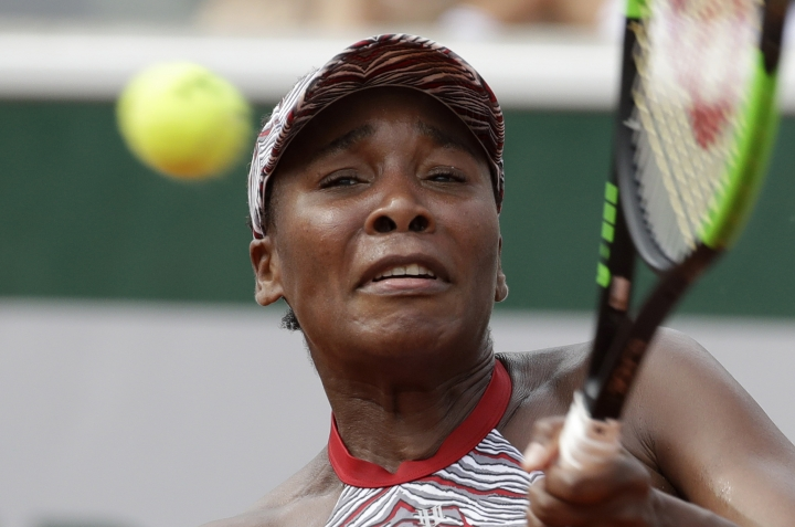 Venus Williams of the U.S. returns the ball to China's Qiang Wang during their first round match of the French Open tennis tournament at the Roland Garros Stadium, Sunday, May 27, 2018 in Paris. (AP Photo/Alessandra Tarantino)