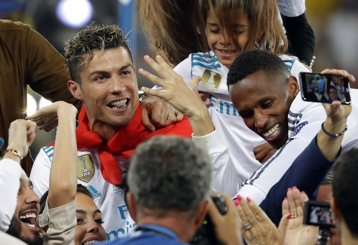 Real Madrid's Cristiano Ronaldo celebrates with fans after winning the Champions League Final soccer match between Real Madrid and Liverpool at the Olimpiyskiy Stadium in Kiev, Ukraine, Saturday, May 26, 2018. (AP Photo/Sergei Grits)