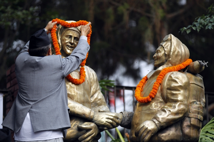 A man puts a garland around the statues of New Zealander Edmund Hillary, left, and his Sherpa guide Tenzing Norgay, who became the first climbers to reach the top of 8,850-meter (29,035-foot) Everest on May 29, 1953 in Kathmandu, Nepal, Tuesday, May 29, 2018. Nepal has honored several Sherpa guides for their own Everest successes on the anniversary of the first conquest of the world's highest peak. (AP Photo/Niranjan Shrestha)