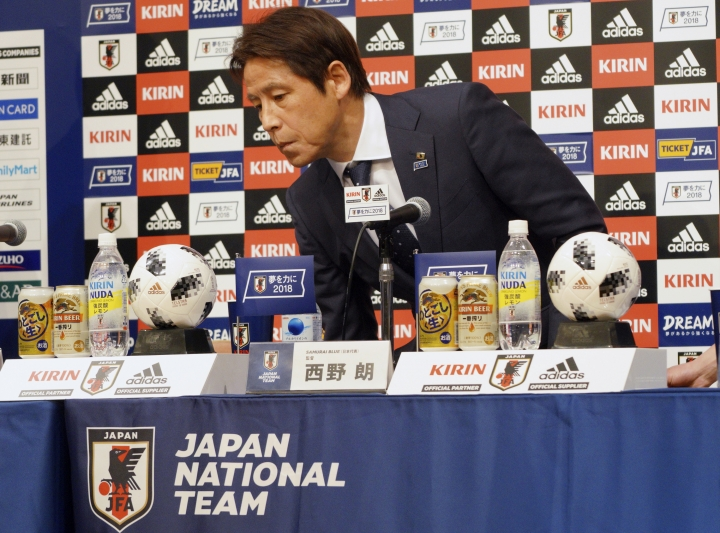 Japanese men's national soccer coach Akira Nishino takes a seat for a press conference to announce Japanese squad members for the World Cup Russia in Tokyo Thursday, May 31, 2018. Nishino named his 23-man World Cup squad, relying heavily on veteran players with previous experience in the tournament. (AP Photo/Eugene Hoshiko)