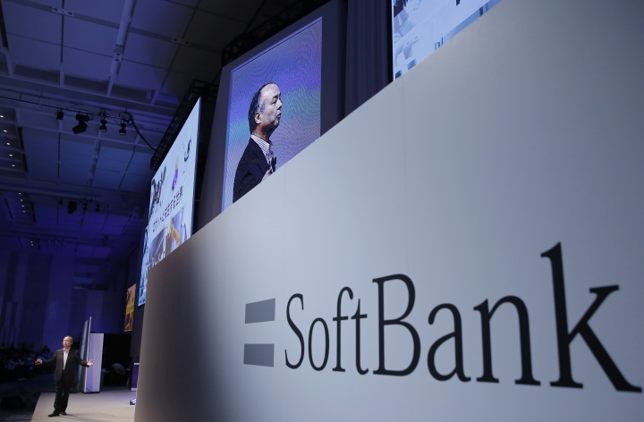 FILE - In this July 20, 2017, file photo, SoftBank Group Corp. Chief Executive Officer Masayoshi Son, left, speaks during a SoftBank World presentation at a hotel in Tokyo. SoftBank will spend $2.25 billion for a nearly a 20 percent stake in General Motors' autonomous vehicle unit. GM said Thursday, May 31, 2018, that it will also sink another $1.1 billion into Cruise Automation. The capital infusion is designed to speed large-scale deployment of self-driving robotaxis next year. (AP Photo/Shizuo Kambayashi, File)