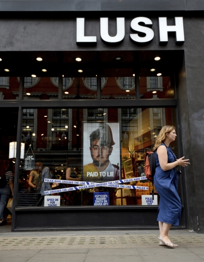 A view of the Lush store on Oxford Street, London, Friday June 1, 2018. Cosmetics retailer Lush has been criticized for using store window displays to criticize undercover police operations. On Friday the windows of more than 100 Lush stores in Britain featured displays supporting the Police Spies Out of Lives campaign. (Kirsty O'Connor/PA via AP)