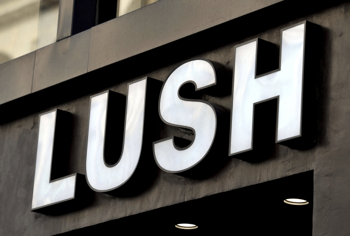 FILE - A June 1, 2016 file photo of a shop sign for LUSH. Cosmetics retailer Lush has been criticized for using store window displays to criticize undercover police operations. On Friday June 1, 2018 the windows of more than 100 Lush stores in Britain featured displays supporting the Police Spies Out of Lives campaign. (Nick Ansell/PA via AP)