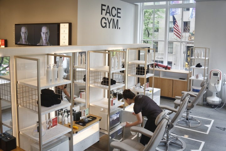 This May 22, 2018, photo shows a facial gym, which is among the new features of the revamped second floor devoted to beauty at Saks Fifth Avenue in New York. Stores like Saks and Macy's are promising workouts for your face, augmented reality and beauty treatment concierges as they try to attract millennial customers and make the cosmetics aisles more of a destination than a stopover. (AP Photo/Bebeto Matthews)