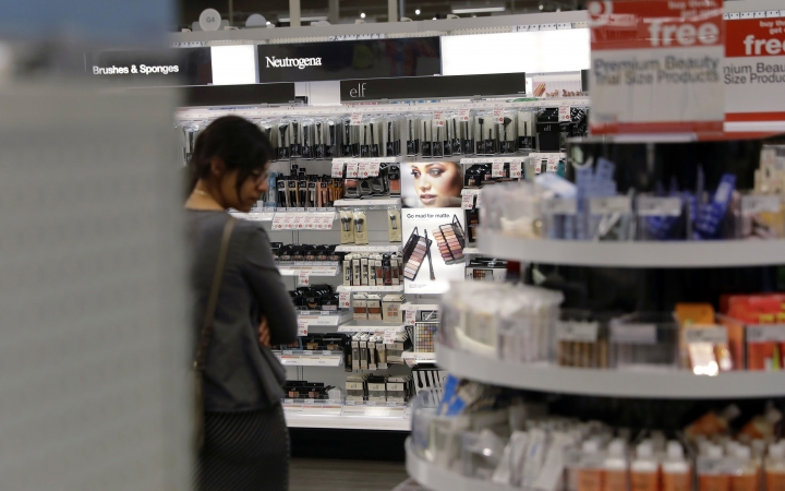 In this May 30, 2018, photo, a shopper looks through the updated cosmetic department at a Target store in San Antonio. Shoppers are changing the way they buy beauty products, fueled by social media, the explosion of new trends and emerging brands. Customers want to experiment with products beyond the brands to which they're loyal. And with information online, they're more knowledgeable when they approach the cosmetics counter. (AP Photo/Eric Gay)