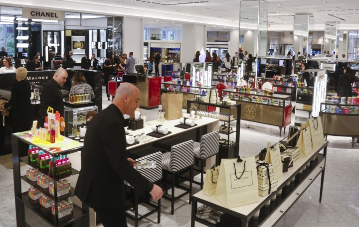 This May 22, 2018, photo a partial view of various vendors on the revamped second floor devoted to beauty at Saks Fifth Avenue in New York. Stores like Saks and Macy's are promising workouts for your face, augmented reality and beauty treatment concierges as they try to attract millennial customers and make the cosmetics aisles more of a destination than a stopover. (AP Photo/Bebeto Matthews)