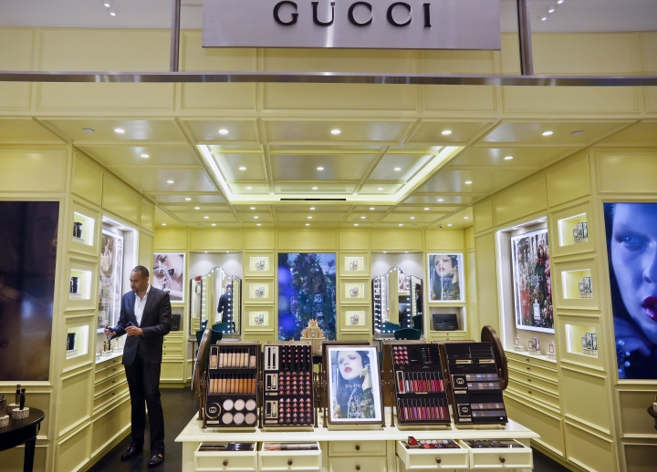 This May 22, 2018, photo shows the new Gucci space is among vendors on the revamped second floor devoted to beauty at Saks Fifth Avenue in New York. Department stores are being forced to rethink how they sell higher-end makeup and perfume as competition intensifies from discounters like Target, specialty chains like Sephora and Ulta and online brands. Saks Fifth Avenue aims to offers an over-the-top beauty experience, with large shops devoted to brands like Chanel and Gucci. (AP Photo/Bebeto Matthews)