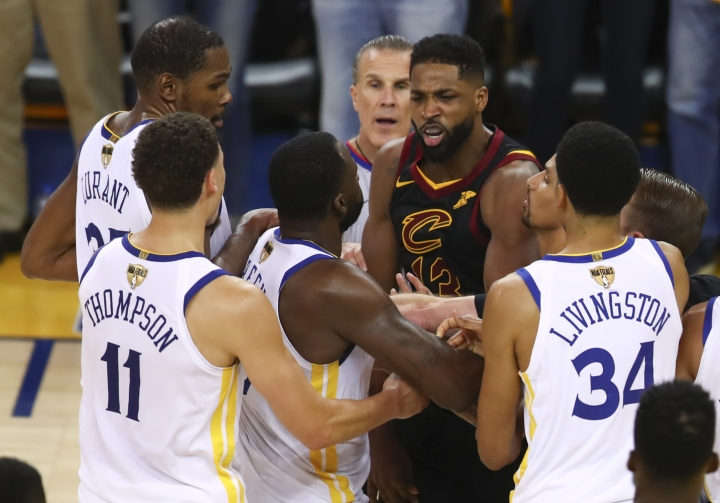 Cleveland Cavaliers center Tristan Thompson, facing, confronts Golden State Warriors forward Draymond Green, second from bottom left, during overtime of Game 1 of basketball's NBA Finals in Oakland, Calif., Thursday, May 31, 2018. The Warriors won 124-114. (AP Photo/Ben Margot)