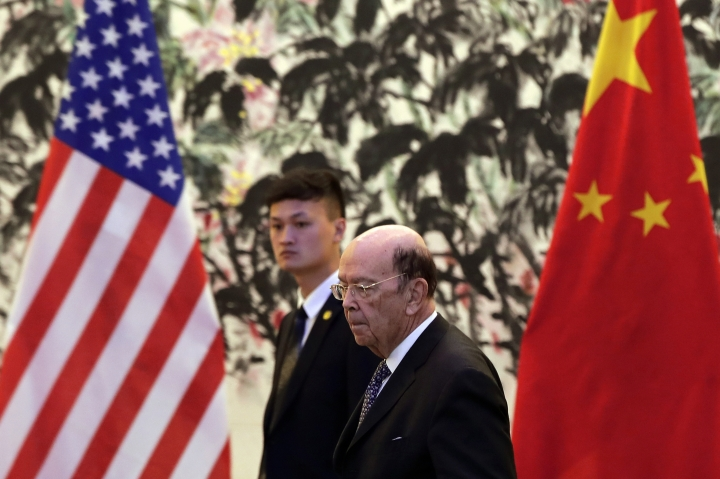 U.S. Commerce Secretary Wilbur Ross arrives to the Diaoyutai State Guesthouse to attend a meeting with Chinese Vice Premier Liu He in Beijing, Sunday, June 3, 2018. U.S. Commerce Secretary Ross is in Beijing for talks on China's promise to buy more American goods after Washington ratcheted up tensions with a new threat of tariff hikes on Chinese high-tech exports. ( (AP Photo/Andy Wong, Pool)