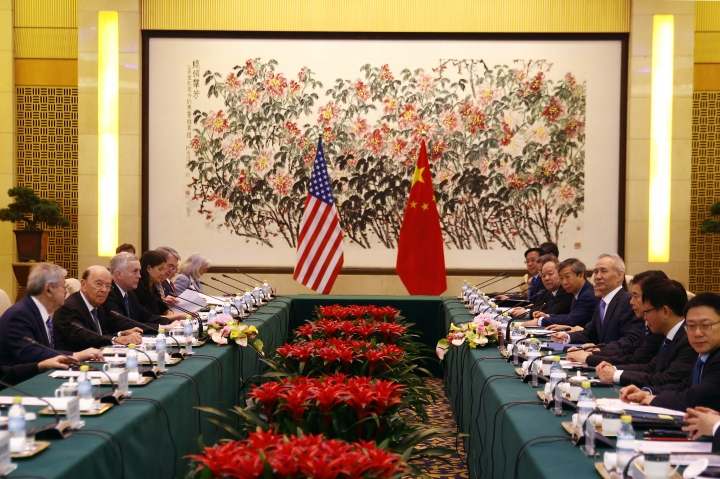 U.S. Commerce Secretary Wilbur Ross, second from left, and Chinese Vice Premier Liu He, fourth right, attend a meeting at the Diaoyutai State Guesthouse in Beijing, Sunday, June 3, 2018. U.S. Commerce Secretary Ross is in Beijing for talks on China's promise to buy more American goods after Washington ratcheted up tensions with a new threat of tariff hikes on Chinese high-tech exports. (AP Photo/Andy Wong, Pool)