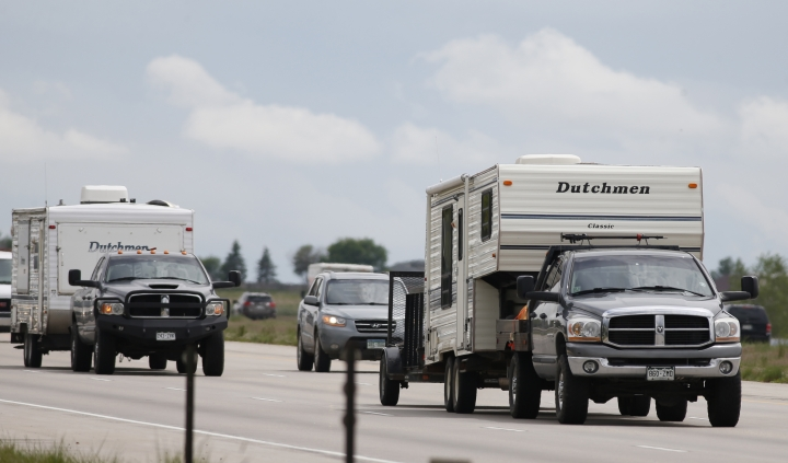 FILE - In this May 27, 2016, file photo, motorists guide their vehicles northbound on Interstate 25 to mark the start of the Memorial Day weekend near Firestone, Colo. Suddenly road trips are trendy again. Surveys from MMGY, Ford and AAA show their popularity is up. Websites, newspapers, magazines and even books are featuring road trips like they're the next big thing _ even though they're actually a longstanding American tradition. (AP Photo/David Zalubowski, File)