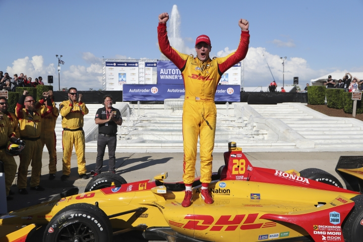 Ryan Hunter-Reay exits his car after winning the second race of the IndyCar Detroit Grand Prix auto racing doubleheader, Sunday, June 3, 2018, in Detroit. (AP Photo/Carlos Osorio)