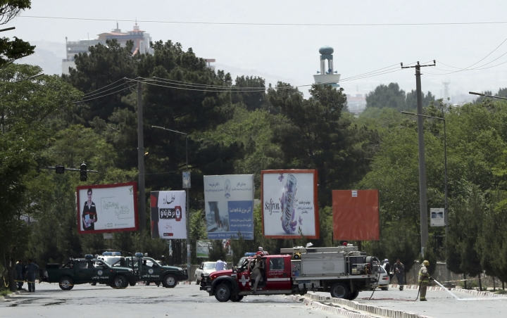 Security personnel attend the site of a deadly suicide attack in Kabul, Afghanistan, Monday, June 4, 2018. A suicide bombing targeted a gathering of Afghanistan's top clerics on Monday in Kabul, killing at least seven people and wounding nine, the police said. (AP Photo/Massoud Hossaini)