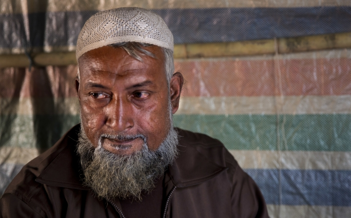 "In this Jan. 16, 2018, photo, Rohingya refugee Rahamat Ullah, 53, a mullah from Koe Fan Kauk village, sits in his makeshift shelter in Kutupalong refugee camp near Cox's Bazar, Bangladesh. ""We are being targeted because people listen to us,"" he said. Associated Press interviews with nearly a dozen Rohingya teachers, elders and religious leaders reveal that educated Rohingya were already subject to systematic and widespread harassment, arrests, torture and, in some cases, killings. (AP Photo/Manish Swarup)"