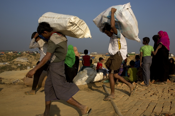 FILE - In this Jan. 24, 2018, file photo, Rohingya refugee Muslims who were staying in no-man's land at Bandarban between Myanmar and Bangladesh border arrive at Balukhali refugee camp 50 kilometers (32 miles) from, Cox's Bazar, Bangladesh . Myanmar and U.N. agencies signed an agreement that might eventually lead to the return of some of the 700,000 Rohingya Muslims who fled brutal persecution by the country's security forces and are now crowded into makeshift camps in Bangladesh. (AP Photo/Manish Swarup/File)