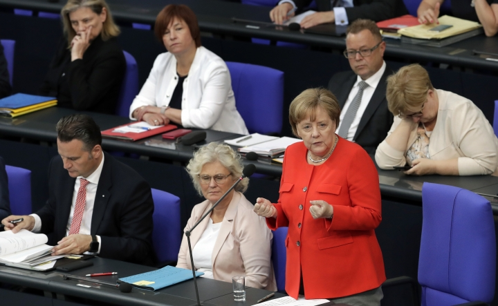 German Chancellor Angela Merkel gestures as she answers questions of lawmakers during a government questioning as part of a meeting of the German parliament, Bundestag, at the Reichstag building in Berlin, Germany, Wednesday, June 6, 2018. (AP Photo/Michael Sohn)