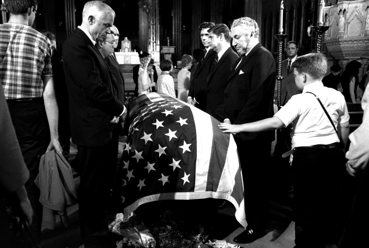 FILE-- In this June 7, 1968 file photograph, a young boy touches the casket of Senator Robert F. Kennedy, D-NY, while paying respects at New York's St. Patrick's Cathedral. The suburban Boston house where Robert F. Kennedy was born, now a national historic site in tribute to his more famous brother, President John F. Kennedy, is holding a special exhibition to mark the 50th anniversary of RFK's assassination on June 6, 1968. (AP Photo/stf)