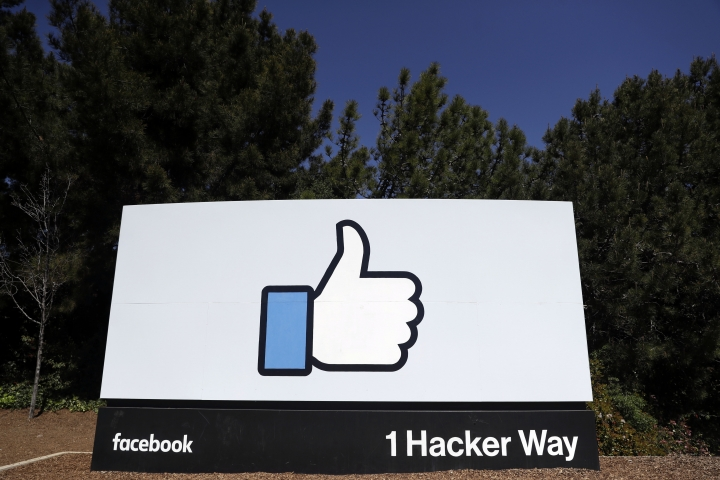 FILE- This March 28, 2018, file photo shows the Facebook logo at the company's headquarters in Menlo Park, Calif. Facebook says it will fund exclusive news shows created for its Watch video section by publishers such as ABC, CNN and Mic. (AP Photo/Marcio Jose Sanchez, File)