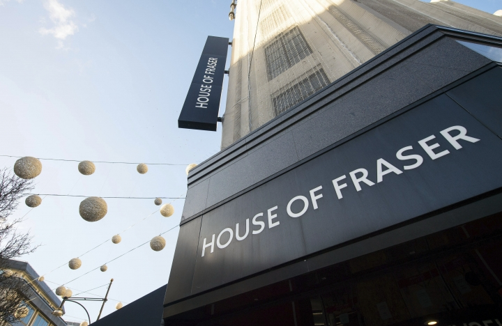 FILE - This Jan. 7, 2018 file photo shows the Oxford Street, London branch of House of Fraser. The move toward online shopping and a Brexit-related rise in prices are causing more pain for British retailers, with department store House of Fraser filing plans in court Wednesday June 6, 2018, saying it plans to close over half its stores, including its flagship premises on London's Oxford Street. (Dominic Lipinski/PA via AP)