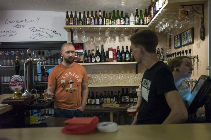 FILE - In this Friday, May 22, 2015 file photo, Stanislav Obraztsov, left, speaks to his colleagues at his craft beer bar in Moscow, Russia. For many fans of food and football, a World Cup in Russia is unfamiliar territory. Russian cuisine has a reputation for being stodgy, unimaginative fare. While that may have been true for many in the days of Soviet supply shortages, a new generation of Russian in the World Cup's host cities mix together influences from across Europe and Asia. (AP Photo/Alexander Zemlianichenko, File)