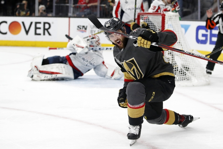 Vegas Golden Knights left wing Tomas Tatar, right, of Slovakia, celebrates a goal by left wing David Perron as Washington Capitals goaltender Braden Holtby, left, lies on the ice during the second period in Game 5 of the NHL hockey Stanley Cup Finals on Thursday, June 7, 2018, in Las Vegas. (AP Photo/John Locher)