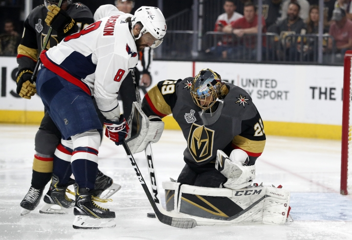 Washington Capitals left wing Alex Ovechkin, of Russia, tries to get a shot past Vegas Golden Knights goaltender Marc-Andre Fleury during the first period in Game 5 of the NHL hockey Stanley Cup Finals on Thursday, June 7, 2018, in Las Vegas. (AP Photo/John Locher)