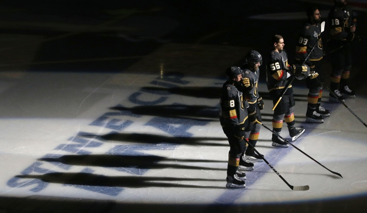 Members of the Vegas Golden Knights line up for the national anthem prior to Game 5 of the NHL hockey Stanley Cup Finals against the Washington Capitals on Thursday, June 7, 2018, in Las Vegas. (AP Photo/Ross D. Franklin)