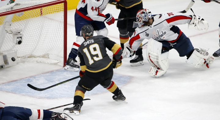 Vegas Golden Knights right wing Reilly Smith, left, scores on Washington Capitals goaltender Braden Holtby during the second period in Game 5 of the NHL hockey Stanley Cup Finals on Thursday, June 7, 2018, in Las Vegas. (AP Photo/Ross D. Franklin)