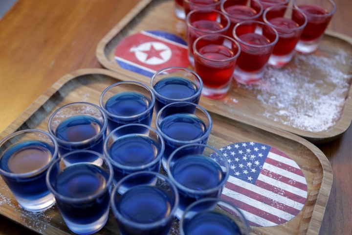 In this June 7, 2018, photo, alcoholic drinks inspired by the upcoming summit between U.S. President Donald Trump and North Korean leader Kim Jong Un is displayed at a local bar, the Escobar, in Singapore. Singapore is a city that takes great pride in its food, so it's not surprising that enterprising restaurateurs are using next week's historic summit between U.S. President Donald Trump and North Korean leader Kim Jong Un to showcase some culinary creativity. Restaurants are marking the city-state's time in the global spotlight with everything from red, white and blue cocktails to tacos named after the two leaders. (AP Photo/Wong Maye-E)