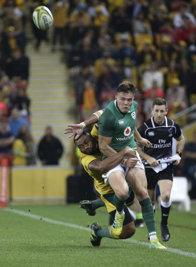 Jacob Stockdale of Ireland, right, is tackled by Sekope Kepu of Australia during the International rugby match between Australia and Ireland in Brisbane, Australia, Saturday, June 9, 2018. (AP Photo/Tertius Pickard)