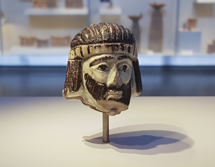 This Monday, June 4, 2018 photo shows a detailed figurine of a king's head on display at the Israel Museum, dating to biblical times, and found last year near Israel's northern border with Lebanon, in Jerusalem. A palm-sized enigmatic sculpture of a king's head dating back nearly 3,000 years has set off a modern-day mystery caper as scholars try to figure out whose face it depicts. The 5-centimeter (2-inch) head is an exceedingly rare example of figurative art from the Holy Land during the 9th century BC, a period associated with biblical kings. (AP Photo/Ilan Ben Zion)