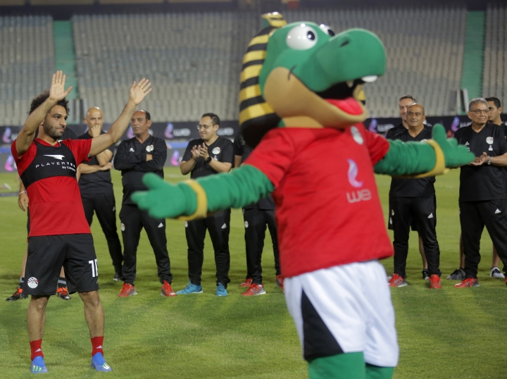 Egyptian national soccer team player and Liverpool's striker Mohammed Salah greets fans during Egypt's final training for the World Cup at Cairo Stadium in Cairo, Egypt, Saturday, June 9, 2018. (AP Photo/Amr Nabil)