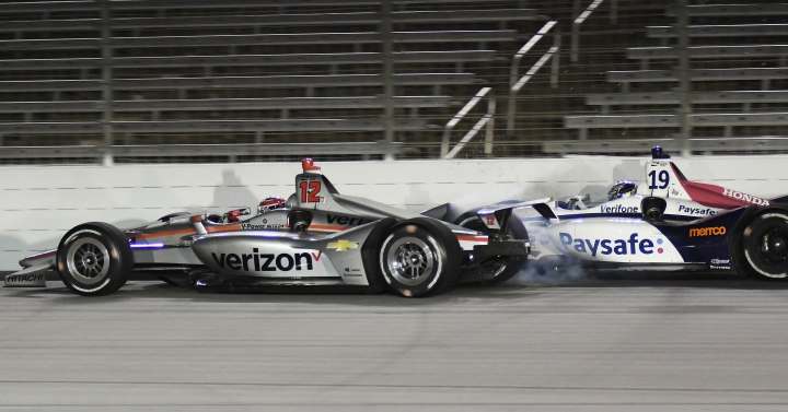 Will Power, left, of Australia, and Zachary Claman de Melo, of Canada, collide during the IndyCar auto race Saturday, June 9, 2018, in Fort Worth, Texas. (AP Photo/Larry Papke)