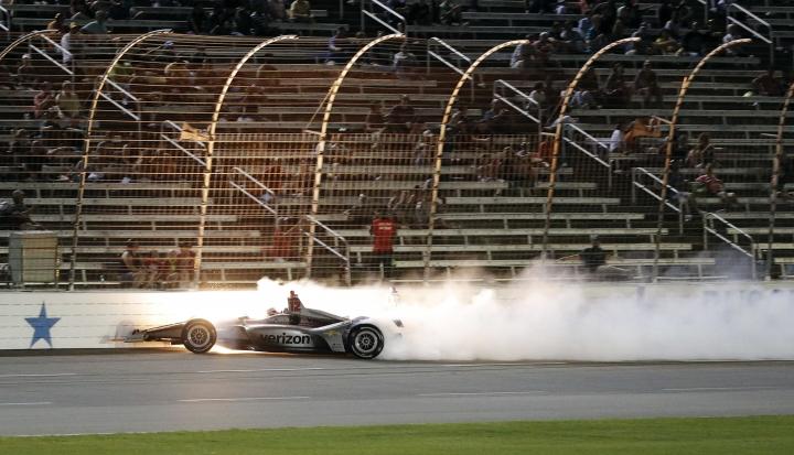 Will Power, of Australia, hits the wall after colliding with Zachary Claman de Melo, obscured in smoke, during the IndyCar auto race Saturday, June 9, 2018, in Fort Worth, Texas. (AP Photo/Brandon Wade)