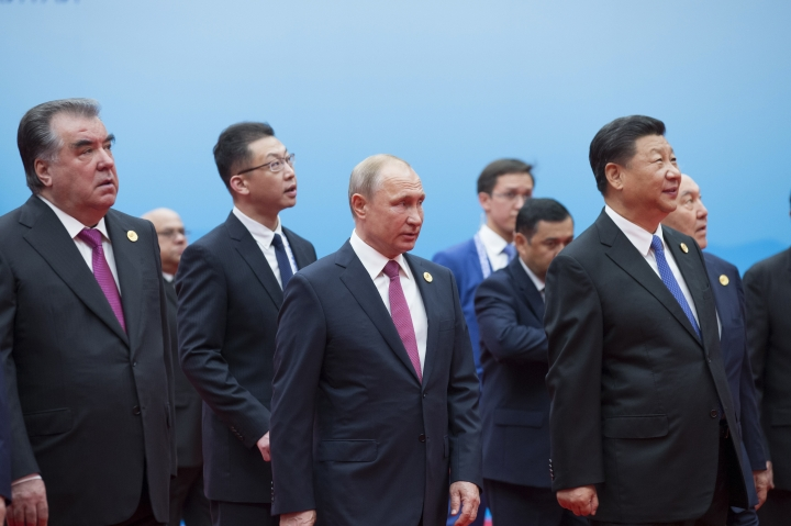 Tajikistan President Imomali Rakhmon, left, Russian President Vladimir Putin, center, and Chinese President Xi Jinping, right, walk to attend talks at the Shanghai Cooperation Organization (SCO) Summit in Qingdao in eastern China's Shandong Province Sunday, June 10, 2018. (AP Photo/Alexander Zemlianichenko)