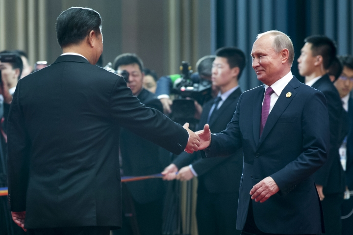 Chinese President Xi Jinping, left, shakes hands with Russian President Vladimir Putin during an arriving ceremony at the Shanghai Cooperation Organization (SCO) Summit in Qingdao in eastern China's Shandong Province Sunday, June 10, 2018. (AP Photo/Alexander Zemlianichenko)