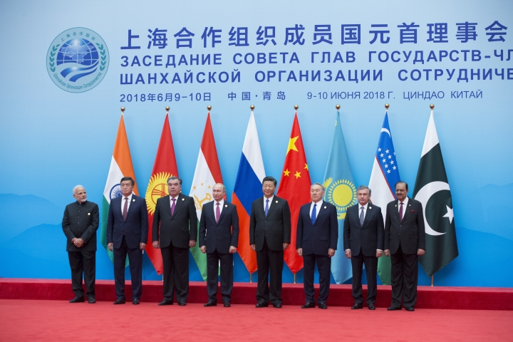 From left: Indian Prime Minister Narendra Modi, Kyrgyz President Sooronbay Jeenbekov, Tajikistan President Imomali Rakhmon, Russian President Vladimir Putin, Chinese President Xi Jinping, Kazakh President Nursultan Nazarbayev, Uzbekistan's President Shavkat Mirziyoyev and Pakistani President Mamnoon Hussain pose for a photo prior to their talks at the Shanghai Cooperation Organization (SCO) Summit in Qingdao in eastern China's Shandong Province Sunday, June 10, 2018. (AP Photo/Alexander Zemlianichenko)
