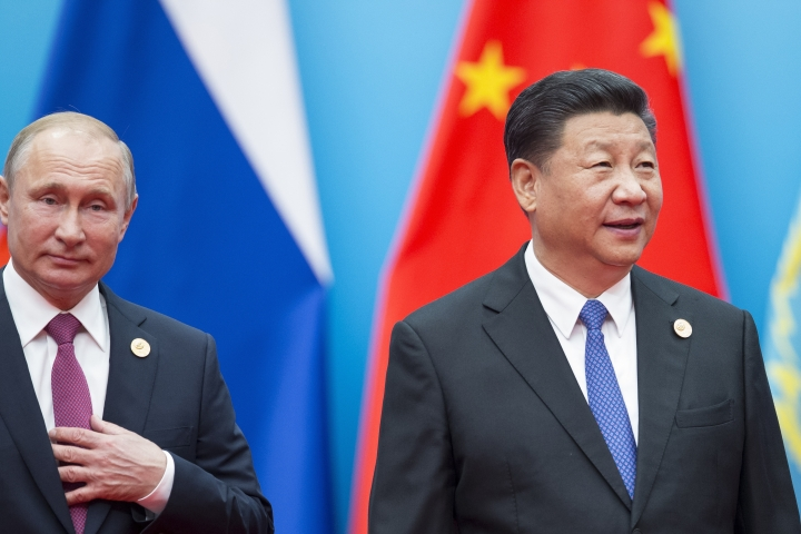 Chinese President Xi Jinping, right, and Russian President Vladimir Putin walk to attend talks at the Shanghai Cooperation Organization (SCO) Summit in Qingdao in eastern China's Shandong Province Sunday, June 10, 2018. (AP Photo/Alexander Zemlianichenko)