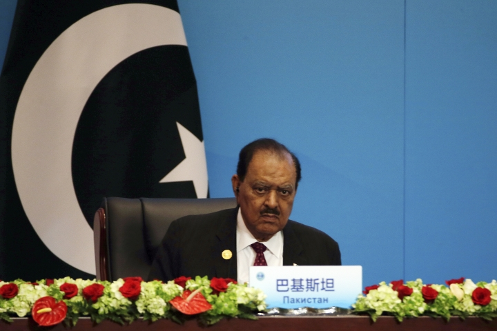 "Pakistan President Mamnoon Hussain looks during the signing ceremony for the Shanghai Cooperation Organization (SCO) Summit in Qingdao in eastern China's Shandong Province, Sunday, June 10, 2018. Xi extolled free trade and criticized ""selfish, short-sighted"" policies during the closely orchestrated gathering, standing in stark contrast with the G-7 summit that ended in disarray over trade tensions. (AP Photo/Dake Kang)"