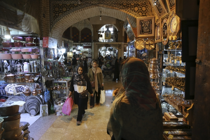"""People shop at the old main bazaar in Tehran, Iran, Saturday, June 9, 2018. For Iran, the so-called """"Axis of Evil"""" has become a lonely party of one as President Donald Trump prepares for direct talks with North Korea. With Saddam Hussein overthrown and Kim Jong Un now preparing for planned meeting in Singapore with Trump, Iran remains the last renegade among former President George W. Bush's grouping of nations opposed to the U.S. It also comes after Trump pulled out of the nuclear deal, worsening Iran's already-anemic economy. (AP Photo/Vahid Salemi)"""