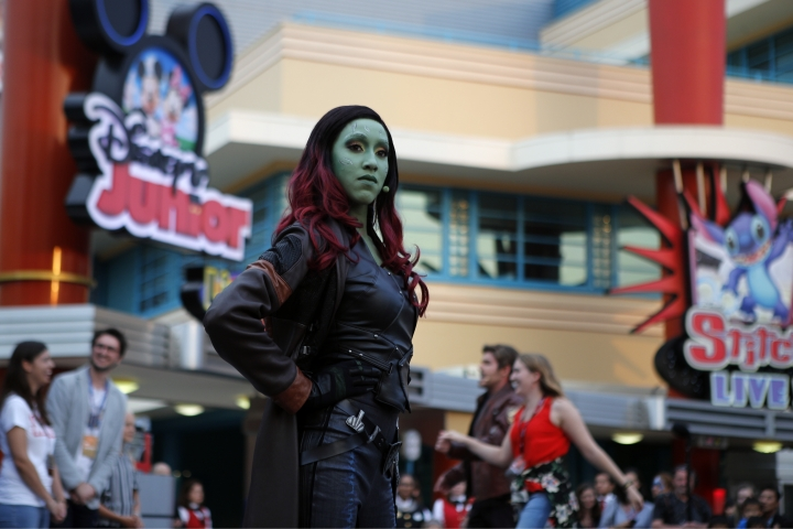 """Gamora"" character of the ""Guardians of the Galaxy"" performs with the guests during the opening show at Disneyland Paris, Saturday, June 8, 2018. Helicopters, concept cars and swat teams shrouded in smoke heralded the launch of the first Avengers-themed season at Disneyland Paris following the announcement of a $2.5 billion expansion plan for the park, which will feature Marvel superheroes. (AP Photo/Francois Mori)"