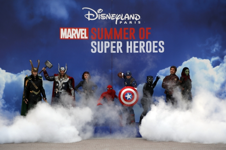 Super heroes characters perform during the opening show at Disneyland Paris, west of Paris, Saturday, June 8, 2018. Helicopters, concept cars and swat teams shrouded in smoke heralded the launch of the first Avengers-themed season at Disneyland Paris following the announcement of a $2.5 billion expansion plan for the park, which will feature Marvel superheroes. (AP Photo/Francois Mori)