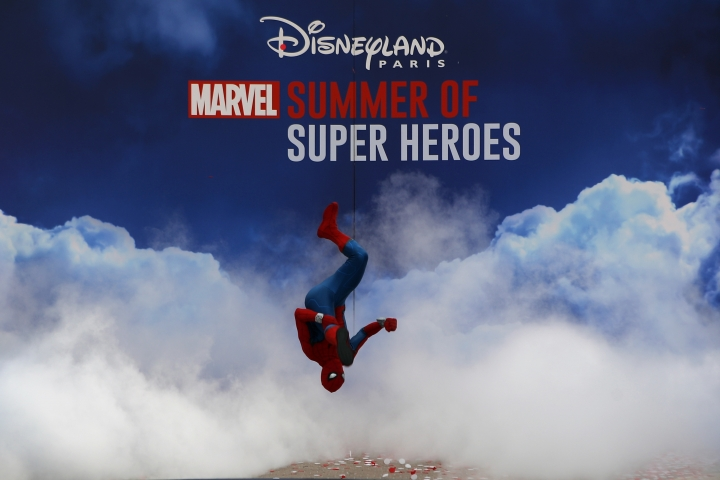 Spiderman character performs during the opening show at Disneyland Paris, west of Paris, Saturday, June 8, 2018. Helicopters, concept cars and swat teams shrouded in smoke heralded the launch of the first Avengers-themed season at Disneyland Paris following the announcement of a $2.5 billion expansion plan for the park, which will feature Marvel superheroes. (AP Photo/Francois Mori)