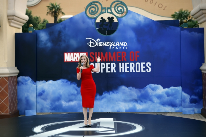 Catherine Powell, CEO of Euro Disney delivers her speech during the opening show at Disneyland Paris, Saturday, June 9, 2018. Helicopters, concept cars and swat teams shrouded in smoke heralded the launch of the first Avengers-themed season at Disneyland Paris following the announcement of a $2.5 billion expansion plan for the park, which will feature Marvel superheroes. (AP Photo/Francois Mori)