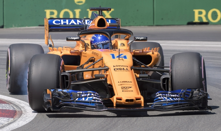 McLaren driver Fernando Alonso of Spain takes a turn at the hairpin during the third practice session for the F1 Canadian Grand Prix auto race, Saturday, June 9, 2018 in Montreal. (Graham Hughes/The Canadian Press via AP)