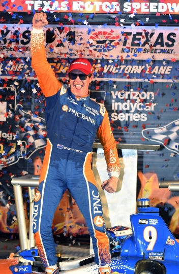 Scott Dixon, of New Zealand, celebrates winning the IndyCar auto race, Saturday, June 9, 2018, in Fort Worth, Texas. (AP Photo/Larry Papke)