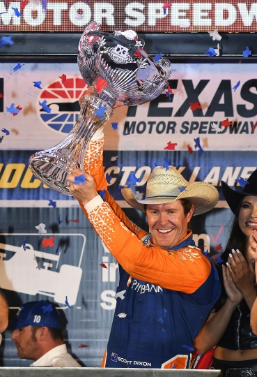 Scott Dixon, of New Zealand, celebrates after winning the IndyCar auto race Saturday, June 9, 2018, in Fort Worth, Texas. (AP Photo/Larry Papke)