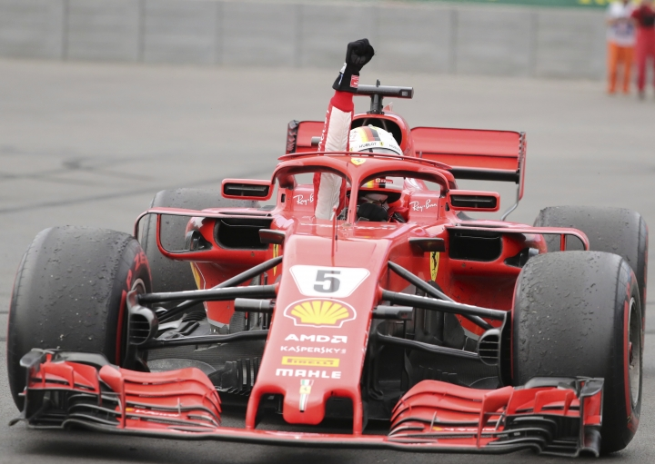 Ferrari driver Sebastian Vettel of Germany celebrates as he drives through the hairpin after winning the Canadian Grand Prix Sunday, June 10, 2018 in Montreal. (Tom Boland/The Canadian Press via AP)