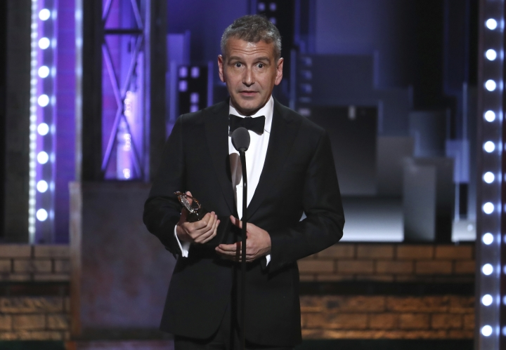 """David Cromer accepts the award for best direction of a musical for """"The Band's Visit"""" at the 72nd annual Tony Awards at Radio City Music Hall on Sunday, June 10, 2018, in New York. (Photo by Michael Zorn/Invision/AP)"""