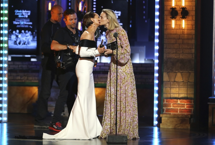 """Laurie Metcalf, left, kisses presenter Carey Mulligan as she accepts the award for best featured actress in a play for """"Edward Albee's Three Tall Women"""" at the 72nd annual Tony Awards at Radio City Music Hall on Sunday, June 10, 2018, in New York. (Photo by Michael Zorn/Invision/AP)"""